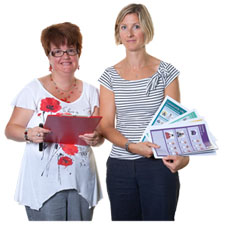 Two ladies holding leaflets