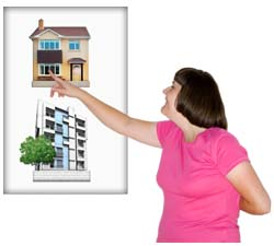 A lady pointing to a house